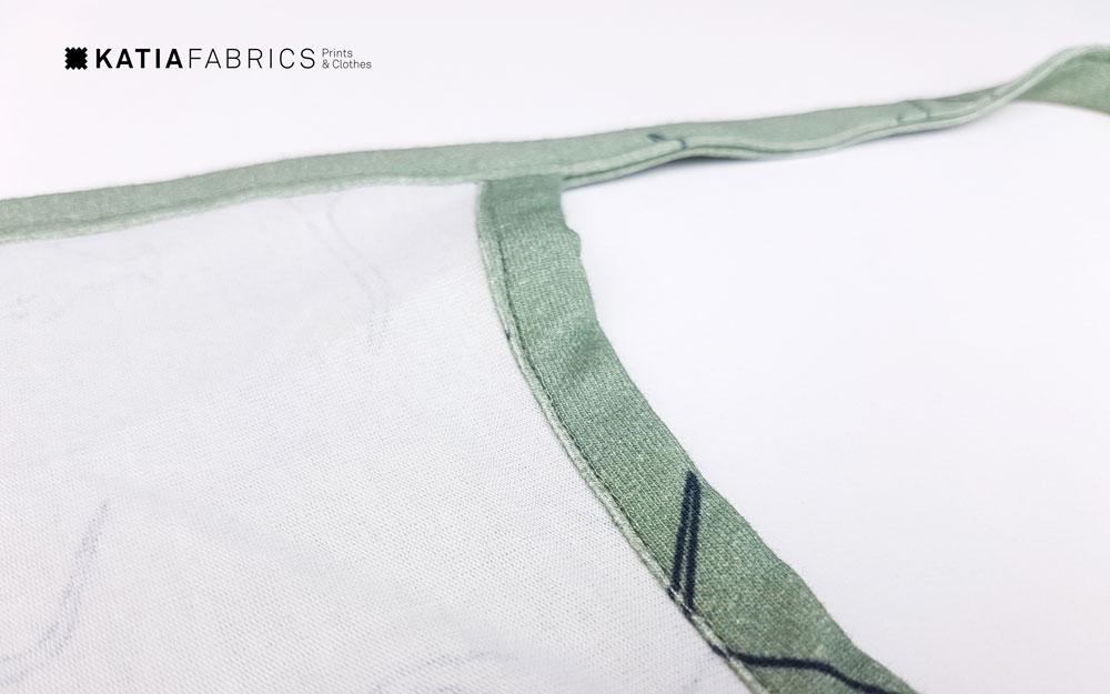 Leer randen afwerken met biaisband en een zak opnaaien met elastische stof - randje